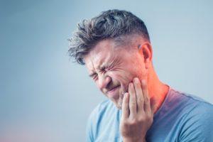 Person Needing Help from Emergency Dentist in Landrum
